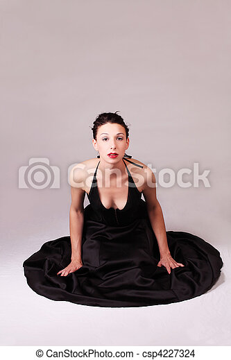 Young caucasian woman sitting on floor in dress - csp4227324