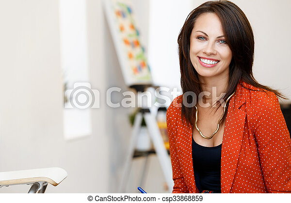 Young caucasian woman standing in art gallery front of paintings - csp33868859
