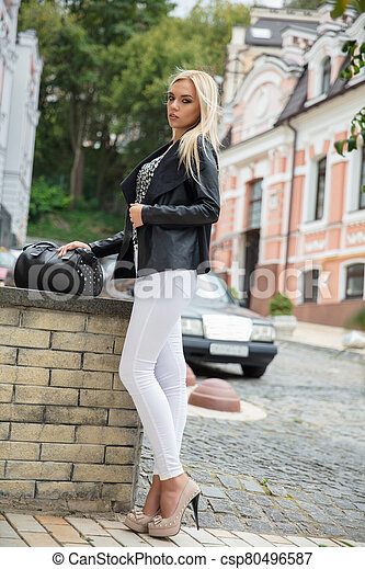 Young charming woman posing on the street - csp80496587