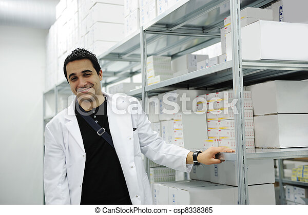 Young cheerful worker in modern drug warehouse - csp8338365