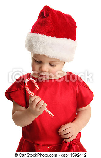 9c4d9dfa5c637 Young child holding and looking at a candy cane. Christmas portrait ...