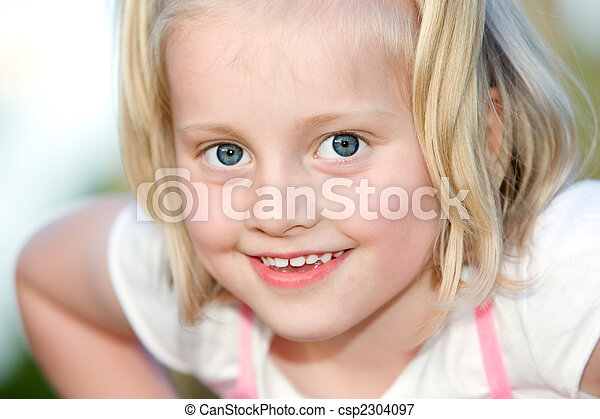 Young child looks happy into the camera - csp2304097