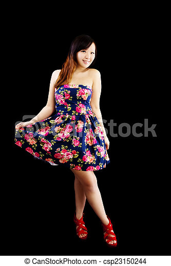 Young Chinese Woman Standing Floral Dress Smiling - csp23150244