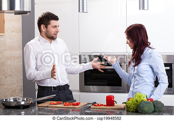 Young couple at kitchen - csp19948582