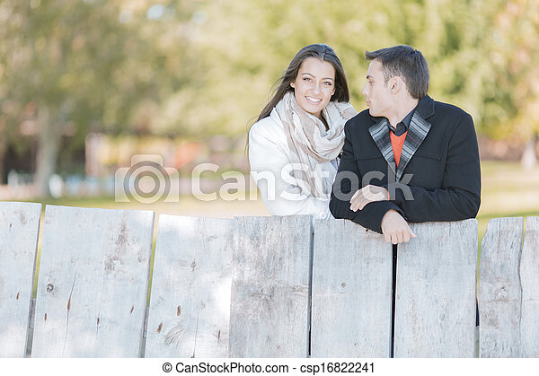 Young couple by the wooden fence - csp16822241