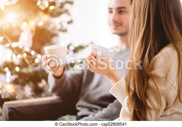 Young couple celebrating Christmas. Holiday love story. - csp52808541
