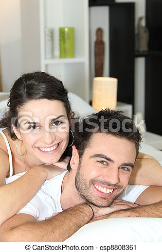 Young couple cheerful laid in bed - csp8808361