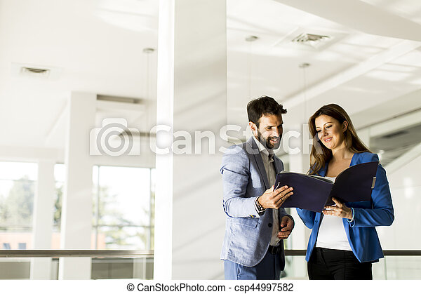 Young couple discussing about business in a modern office - csp44997582