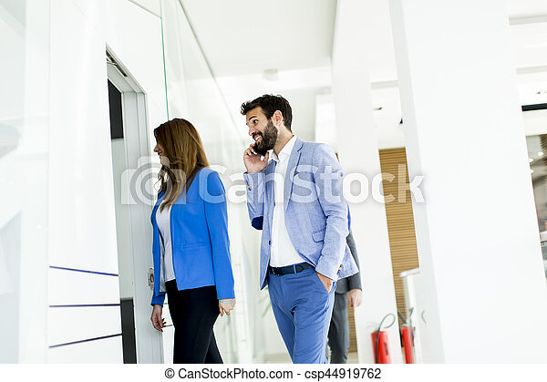 Young couple discussing about business in a modern office - csp44919762