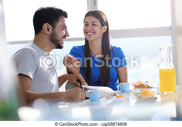 Young Couple Eating Breakfast At Home On Sunday - csp58874608