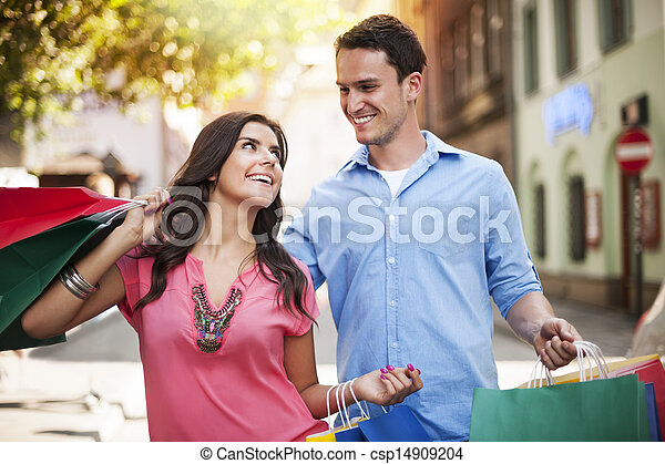 Young couple enjoying shopping together  - csp14909204