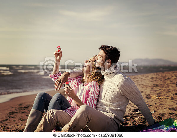 young couple enjoying time together at beach - csp59091060