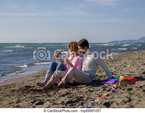 young couple enjoying time together at beach - csp59091057
