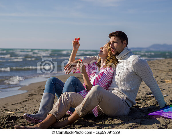 young couple enjoying time together at beach - csp59091329