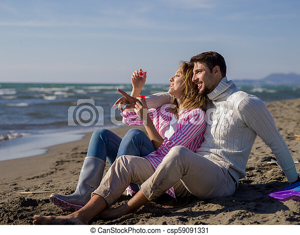 young couple enjoying time together at beach - csp59091331