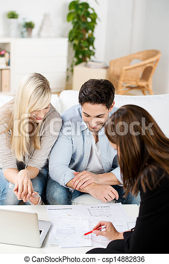 Young couple in a business meeting - csp14882836