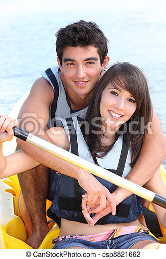 Young couple in a paddle boat - csp8821662