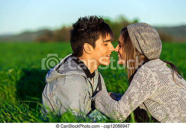 Young couple in countryside showing affection. - csp12086947