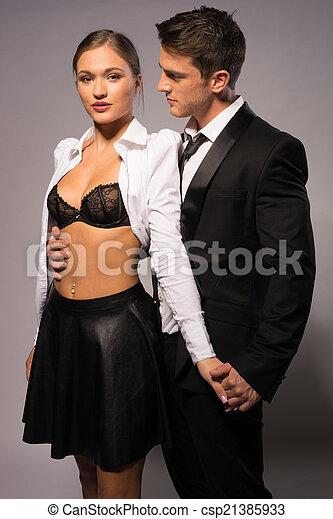 pretty young couple in fashion corporate attire portrait isolated