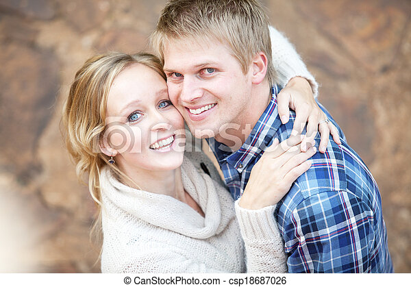 Young couple in love looking up at viewer - csp18687026