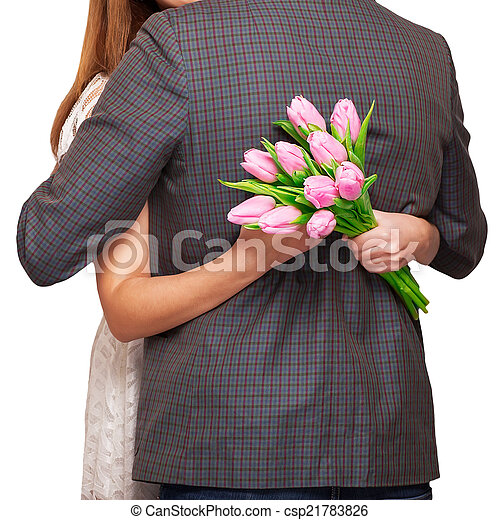 Young couple in love make a heart and hands are holding a bouque - csp21783826