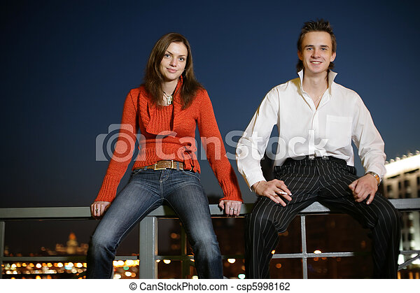 Young couple in night city - csp5998162