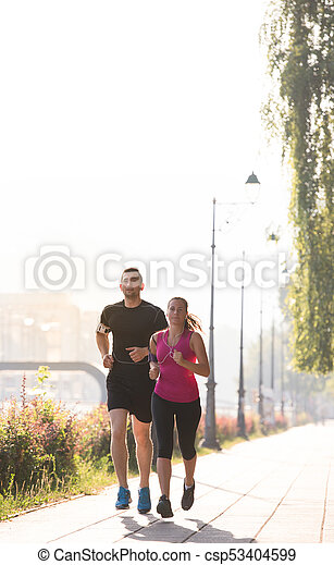young couple jogging  in the city - csp53404599