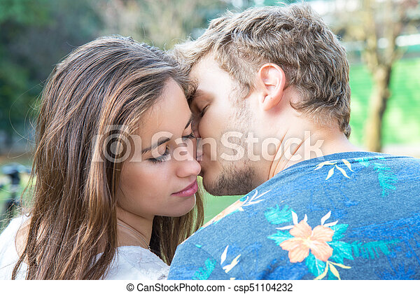 Beautiful Young Couple Kissing Passionately
