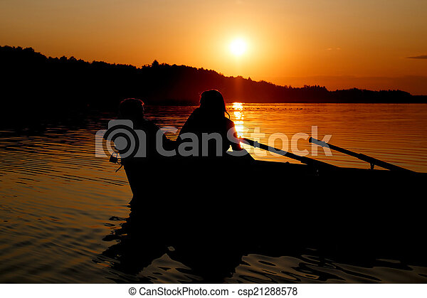 Young couple making romance in the boat - csp21288578