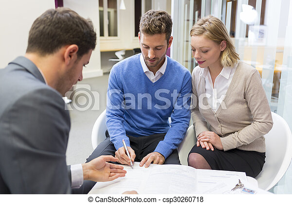 Young couple meeting real-estate agent for house investment. Signing a contract - csp30260718