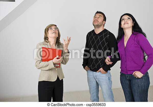 Young couple meeting with estate agent - csp3559633