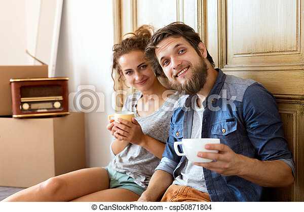 Young couple moving in new house, resting. - csp50871804
