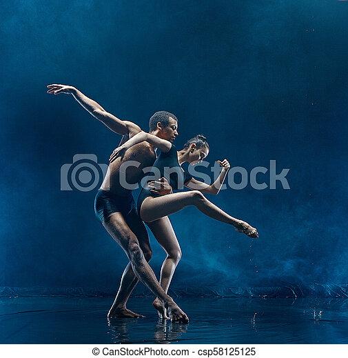 Young couple of ballet dancers dancing unde rwater drops - csp58125125