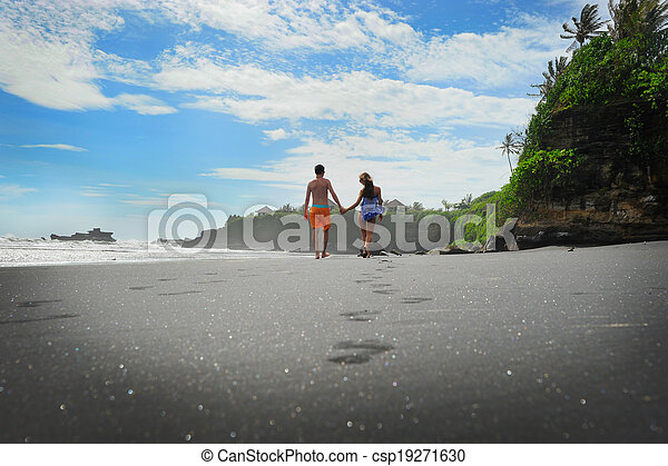 Young couple on a beach - csp19271630