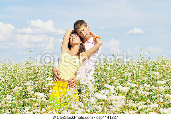 Young couple on field of flowers - csp4141227