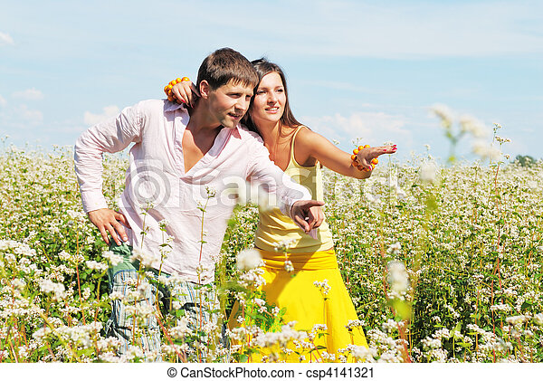 Young couple on field of flowers - csp4141321