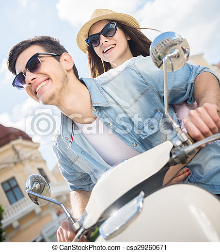 Young couple on scooter - csp29260671