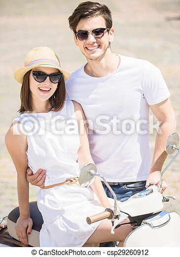 Young couple on scooter - csp29260912