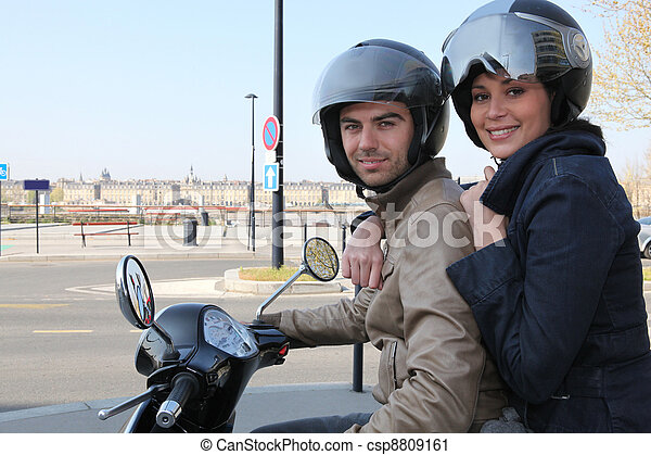 Young couple on scooter - csp8809161