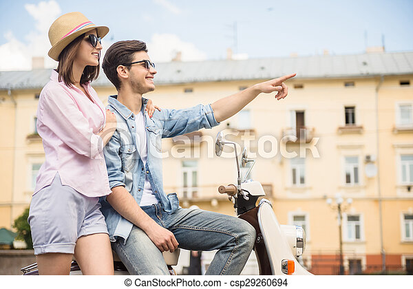 Young couple on scooter - csp29260694
