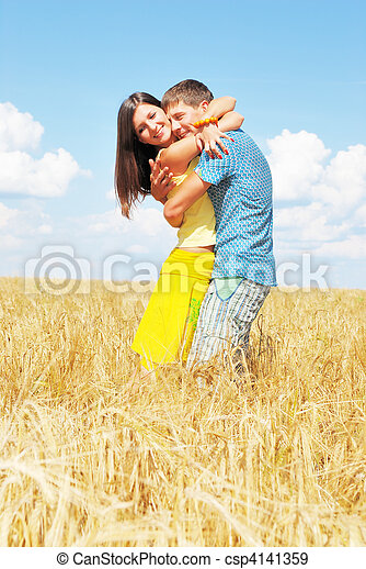 Young couple on wheat field - csp4141359