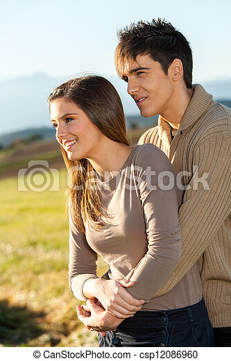 Young couple outdoors in rural field. - csp12086960