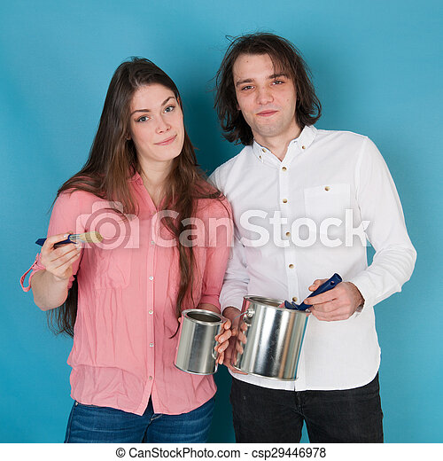Young couple painting house - csp29446978