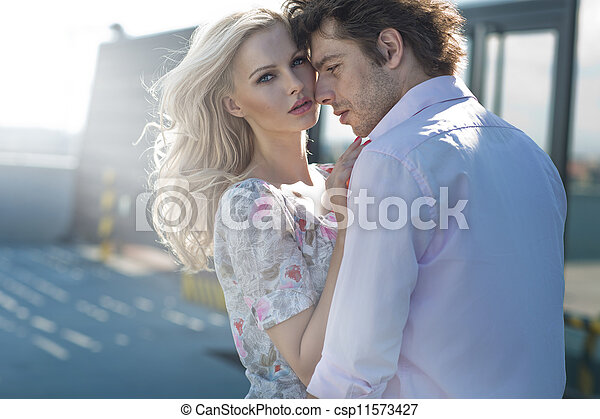 Young couple posing in urban scene - csp11573427