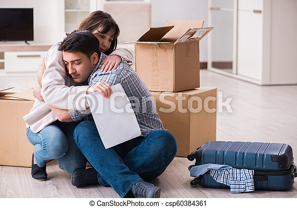 Young couple receiving foreclosure notice letter - csp60384361