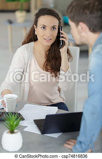 young couple receiving foreclosure notice letter - csp74816836