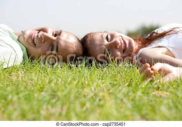 Young couple relaxing on a lawn - csp2735451