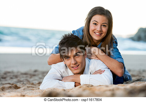 Young couple relaxing on beach at sunset. - csp11617804
