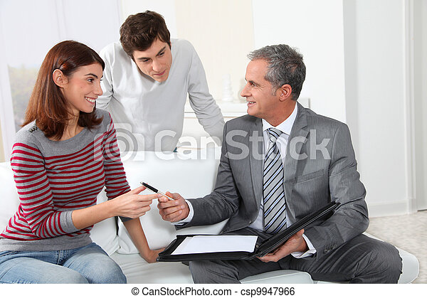 Young couple signing renting contract with real estate agent - csp9947966