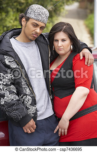 Young Couple Standing Next To Car - csp7436695